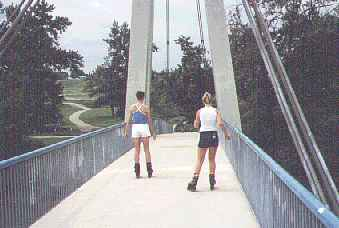 girls crossing a bridge  -  11 kb
